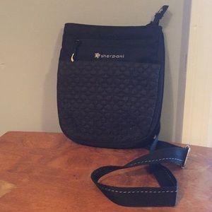Sherpani black over the shoulder bag
